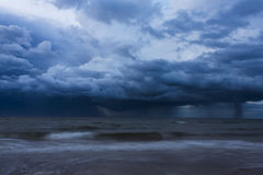 Thunderstorm over the Ocean. A thunderstorm rolls over the Atlantic Ocean in the evening royalty free stock photo