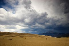 Thunderstorm over sand dunes Royalty Free Stock Photo
