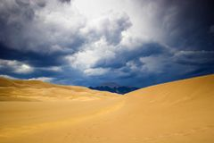 Thunderstorm over sand dunes Royalty Free Stock Image