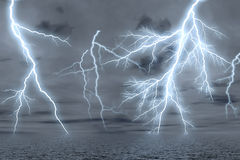 Thunderstorm over the sea. Stock Photos