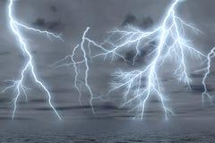 Thunderstorm over the sea. Stock Photos