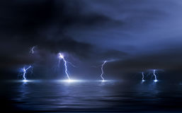 Thunderstorm over the sea, lightning beats the water Royalty Free Stock Images