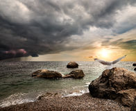 Thunderstorm over sea. Storm clouds and lightning over the sea Royalty Free Stock Photo