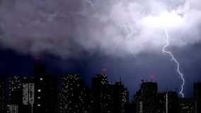 Thunderstorm and rain break over the city, lightning bolts above skyscrapers. Stock footage Royalty Free Stock Images