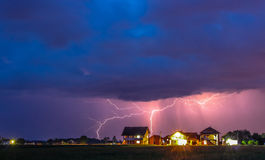 Thunderstorm with rain over the village street Stock Photo