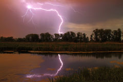 Thunderstorm on the river Stock Photos