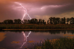Thunderstorm on the river. In summer Stock Photography