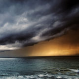 Thunderstorm / Storm Passing over Sea. Storm Passing over Sea with Dark Clouds and Rain royalty free stock photography