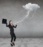 Thunderstorm strikes to businesswoman. In the gray room Stock Photo