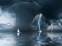 Thunderstorm and yacht at the ocean. Yacht at the ocean, comes nearer a thunderstorm with rain and lightning on background Royalty Free Stock Photos