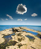Thundery little cloud at shore Royalty Free Stock Photo