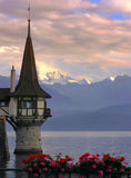Thunersee in twilight. Lake and romantic castle in Switserland just before sunset Stock Photos