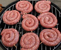 Thuringian Bratwurst. (round fried sausage) on a barbecue grill (german delicacy stock photos
