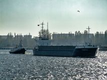 Thurkus general cargo vessel leaves Swinoujscie in Poland. Photo in panoramic facebook background format stock photography