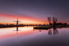 Thurne Mill Dawn. Thurne mill reflected in the still water of the river at dawn Royalty Free Stock Photos