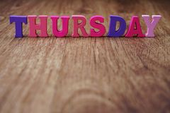 Thursday alphabet letter with space copy on wooden background. Colorful thursday alphabet letter with space copy on wooden background stock photos