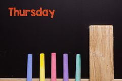 Thursday on Blackboard with chalk and eraser. In classroom at school or business Stock Photo