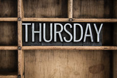 Thursday Concept Metal Letterpress Word in Drawer. The word THURSDAY written in vintage metal letterpress type in a wooden drawer with dividers Royalty Free Stock Image