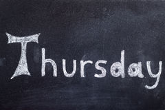 Thursday handwritten on blackboard Royalty Free Stock Images
