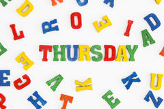 Thursday. Series Weekday: word Thursday in wooden letters on white background Royalty Free Stock Image