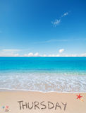 Thursday on a tropical beach under clouds. Thursday written on a tropical beach under clouds stock photos