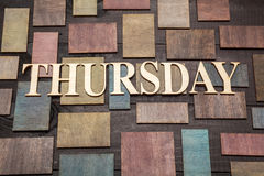 Thursday. Wooden letters forming word THURSDAY written on wooden background Royalty Free Stock Photo