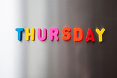 Thursday. The word `Thursday` with colorful letters on gray fridge Royalty Free Stock Images
