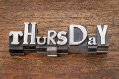 Thursday word in mixed vintage metal type. Printing blocks over grunge wood Royalty Free Stock Images