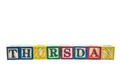 Thursday written in letter colorful alphabet blocks isolated on Royalty Free Stock Photos