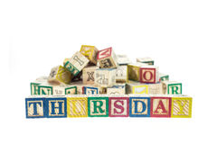 Thursday written in letter colorful alphabet blocks isolated on Royalty Free Stock Photo