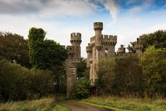 Thurso Castle, Scotland. In far northern Scotland the Thurso castle ilooks abandoned and overgrown, but the turrets and towers remain intact Royalty Free Stock Images