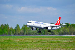 THY Turkish Airlines Airbus A321 airplane is landing on the runway in Pulkovo International airport in Saint-Petersburg, Russia Royalty Free Stock Images