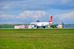 THY Turkish Airlines Airbus A321 airplane is landing on the runway in Pulkovo International airport in Saint-Petersburg, Russia Royalty Free Stock Photo