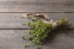 Thyme bunch on  wooden table Royalty Free Stock Photo