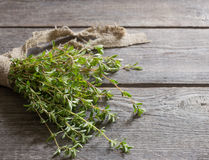 Thyme bunch on wooden table Royalty Free Stock Image