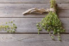 Thyme bunch on  wooden table Royalty Free Stock Photos