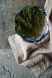 Thyme in a ceramic bowl Gzhel on a napkin Stock Image