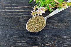 Thyme dry in spoon on board top Stock Image