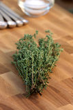 Thyme on fine wood cutting board Royalty Free Stock Photo