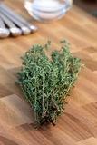 Thyme on fine wood cutting board Stock Images