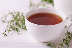 Thyme herbal tea. Healthy drink. Alternative medicine Stock Photo