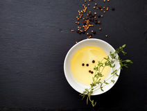Thyme and olive oil in a cup Royalty Free Stock Photos