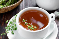 Thyme tea. In a cup and fresh herbs Royalty Free Stock Photo