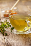 Thyme tea in glass cup Royalty Free Stock Photos