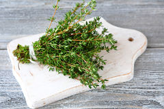 Thyme on a white chopping board Royalty Free Stock Photography