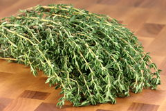 Thyme on wood cutting board Royalty Free Stock Images