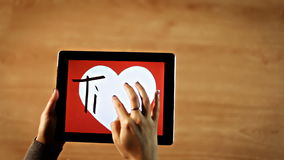 Ti amo calligraphy. Female writing inside white heart on tablet stock video footage