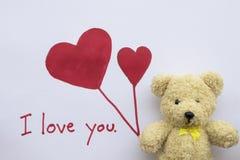 Ti amo carta del messaggio con il cuore rosso di tiraggio fotografia stock