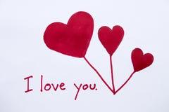 Ti amo carta del messaggio con il cuore rosso di tiraggio fotografie stock