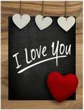 Ti amo hangi del cuore del biglietto di S. Valentino bianco di amore della lavagna del messaggio Fotografia Stock